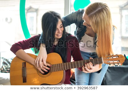 Musician with her guitar Stock photo © photography33