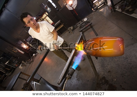 man holding blowtorch stock photo © photography33