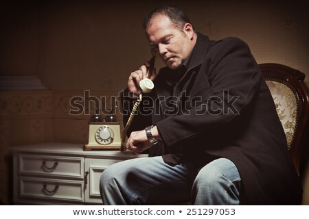 Mobster in a dark room Stock photo © sumners