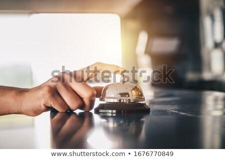 Porteiro fora sino secretária foco negócio Foto stock © stockyimages