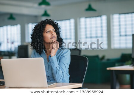 businesswoman sitting at her desk and thinking Stock photo © photography33