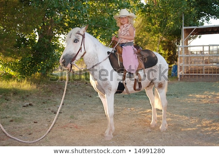 cute curly girl in a cowboy hat stock photo © oleksandro