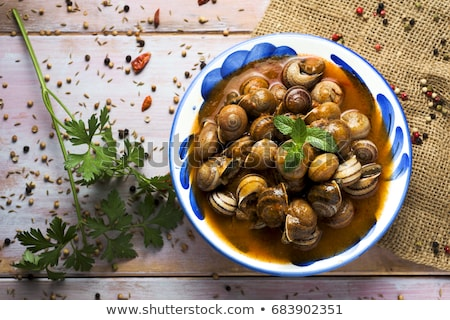 land snails in sauce, gastronomy Stock photo © marimorena
