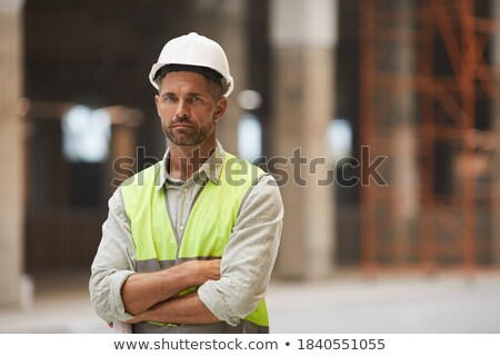 Construction worker with arms crossed stock photo © elenaphoto