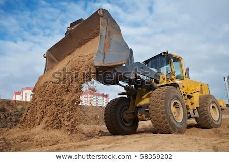 Kotrógép homok építkezés munka természet narancs Stock fotó © ABBPhoto