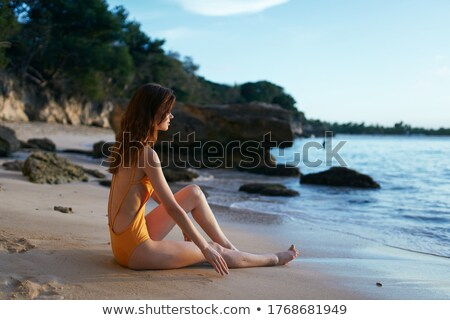 女性 座って ビーチ 黄色 帽子 ストックフォト © travnikovstudio