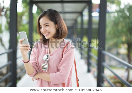 young asian woman walk stock photo © elwynn