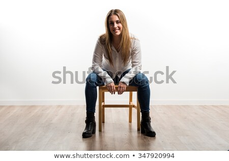 woman sitting in wood chair Stock photo © chesterf