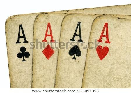 close up of 4 old vintage dirty aces poker cards stock photo © latent