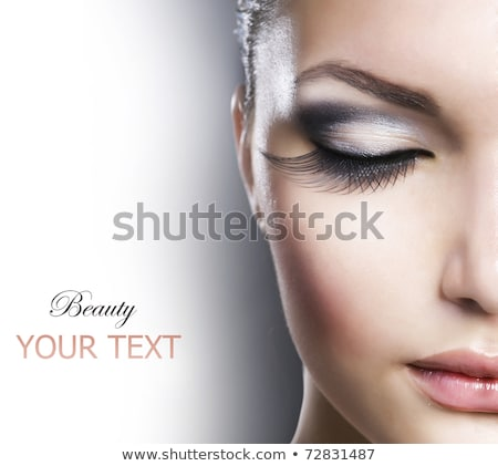 young beautiful brunette woman with make up isolated on dark background stock photo © nejron