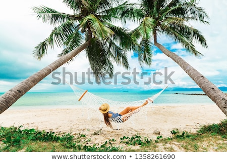 mulher · praia · pôr · do · sol · menina · verão · viajar - foto stock © kasto