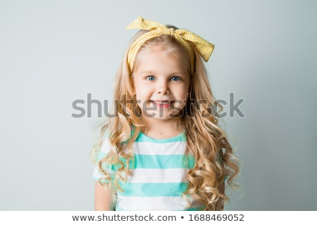 adorable blonde haired and blue eyed little girl in chair stock photo © feverpitch
