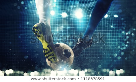 Attack soccer player shooting to defense team  Stock photo © hin255