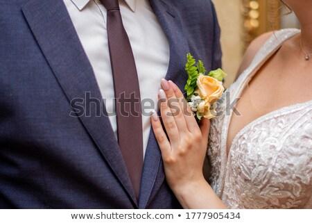 hands fiancee on the buttonhole of groom Stock photo © konturvid