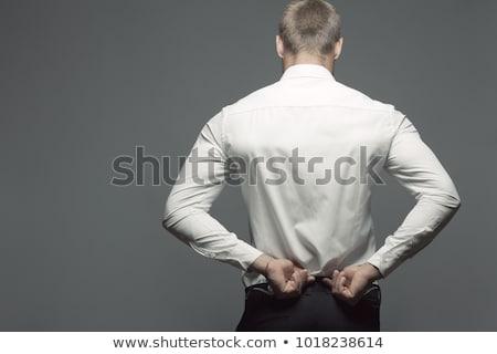 handsome sportsman posing over white background stock photo © deandrobot