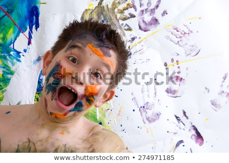 Excited happy little boy doing finger painting stock photo © ozgur
