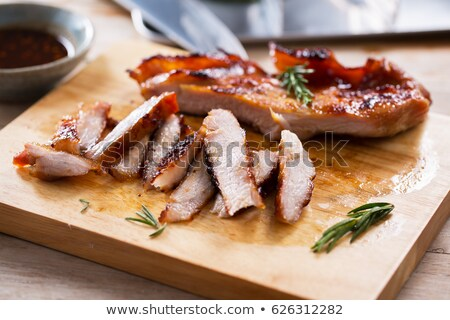 Grilling pork meat chops on barbecue Stock photo © stevanovicigor