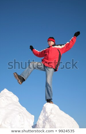 man steps from one snowy chunk to another Stock photo © Paha_L