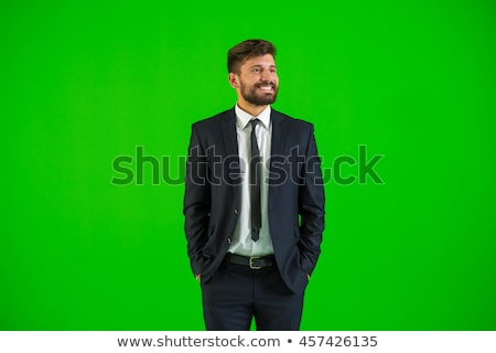 Happy businessman standing with hands in pocket  Stock photo © deandrobot
