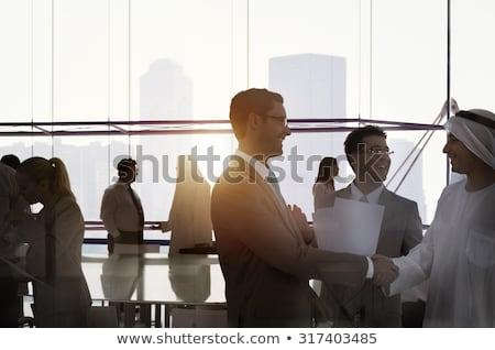 Zakenlieden midden oosten handen schudden hand achtergrond zakenman Stockfoto © zurijeta