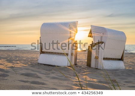 beach with beach chairs of baltic sea in the evening Stock photo © meinzahn