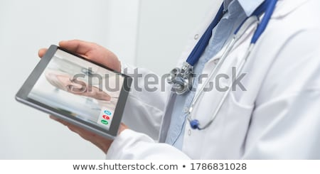 Tablet with the diagnosis Headache on the display Stock photo © Zerbor