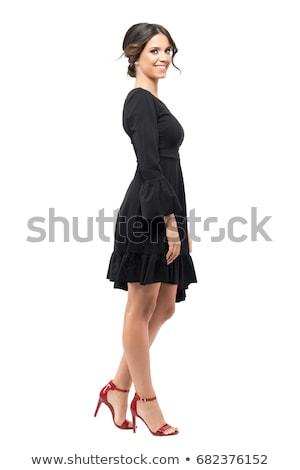 full length portrait of a woman posing in black dress stock photo © deandrobot