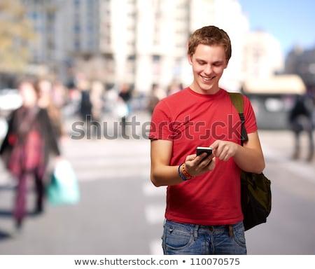homem · mochila · falante · telefone · móvel · cidade · alegre - foto stock © deandrobot