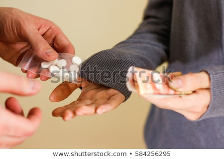 close up of addict or drug dealer hands with money Stock photo © dolgachov