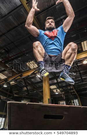 Athletic man with intense face and beard wearing a blue tee shir Stock photo © Yatsenko