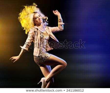 Pretty young blonde in the night club Stock photo © majdansky