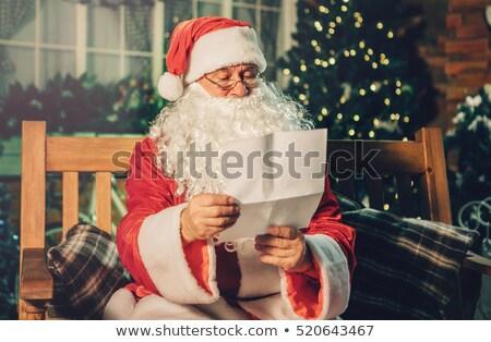 Kerstman lezing scroll woonkamer home man Stockfoto © wavebreak_media