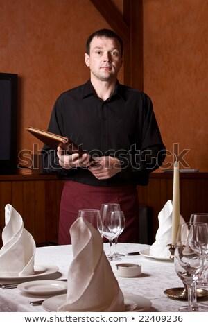 maduro · casal · jovem · garçom · restaurante · mulheres - foto stock © is2
