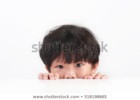 boy looking over table edge Stock photo © IS2