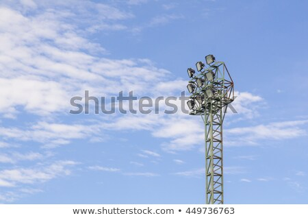 Large floodlight stand against the blue sky Stock photo © Mps197