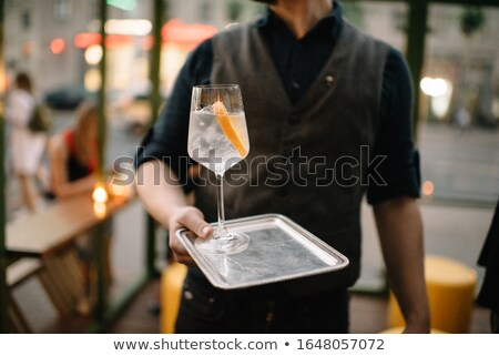 Hand holds tray with sparkling water soda drink Stock photo © DenisMArt