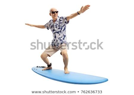 Uomo piedi tavola da surf sorridere spiaggia sport Foto d'archivio © IS2