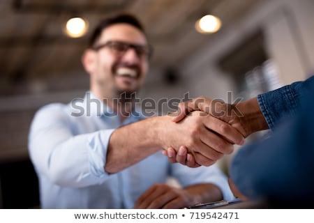 altos · empresario · apretón · de · manos · oficina · sonriendo · mano - foto stock © is2