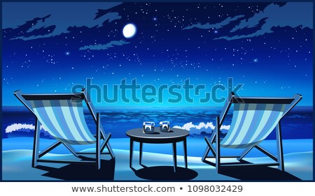 Two chaise lounges on the beach at night Stock photo © tracer