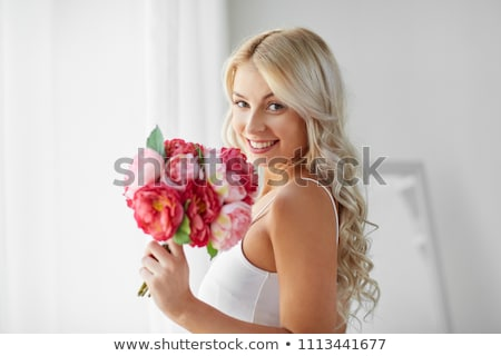 woman in underwear with bunch of flowers at window Stock photo © dolgachov