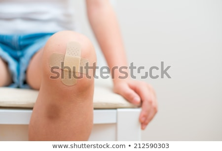 Doctors helping hurt child Stock photo © bluering