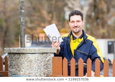 почтальон письма почтовый ящик человека Дать велосипед Сток-фото © Kzenon