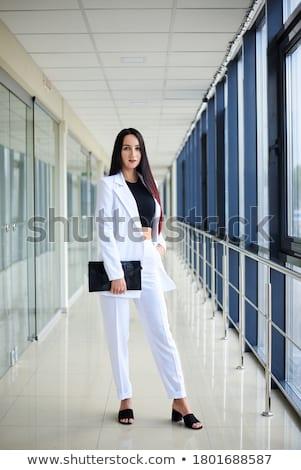 тонкий брюнетка кошелька коричневый платье Сток-фото © acidgrey