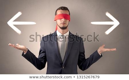 покрытый глаза бизнесмен направлении два Сток-фото © ra2studio