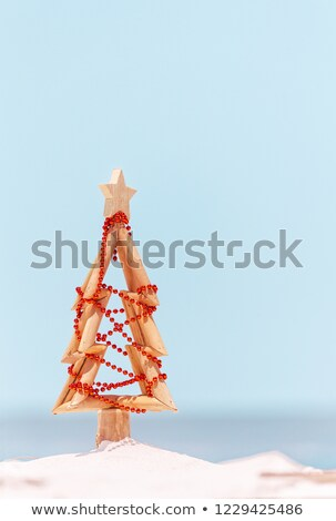 Rustic timber driftwood Christmas tree in sand by the beach Stock photo © lovleah