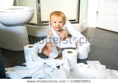 Toddler ripping up toilet paper in bathroom Stock photo © Lopolo
