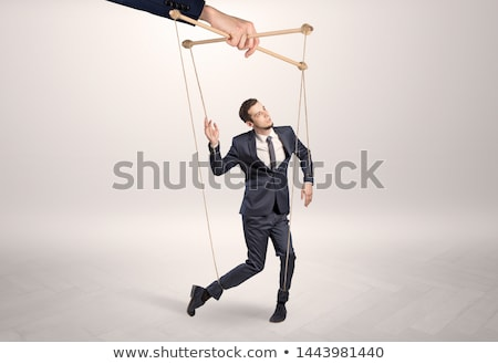 Puppet businessman leaded by a huge hand Stock photo © ra2studio