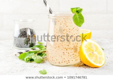 Glass of juice with chia seeds Stock photo © Alex9500