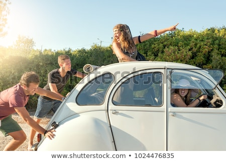 friends pushing broken convertible car stock photo © dolgachov