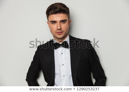 Stock photo: portrait of attractie groom wearing black tuxedo and bowtie stan